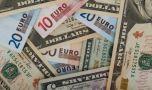 Curs valutar: Euro face un pas înapoi, dolarul se ține tare