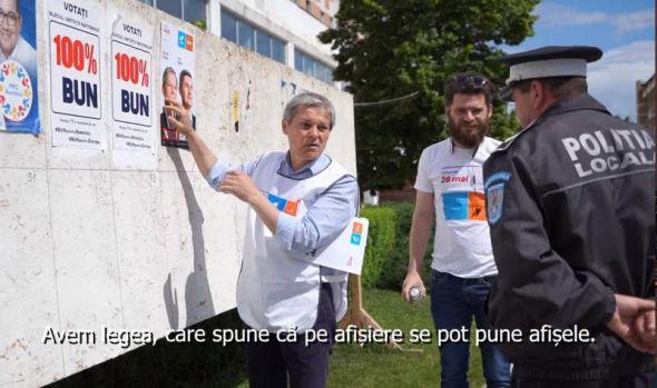Dacian Cioloș, luat la întrebări de un polițist local din Alexandria pentru că lipea un afiș electoral cu alianța USR-Plus! Video